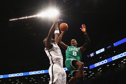 Jeff Green #8 of the Boston Celtics shoots against Kevin Garnett #2 of the Brooklyn Nets during their game at the Barclays Center on December 10, 2013 in the Brooklyn borough of New York City. NOTE TO USER: User expressly acknowledges and agrees that, by downloading and or using this photograph, User is consenting to the terms and conditions of the Getty Images License Agreement.