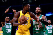 Julius Randle #30 of the Los Angeles Lakers reacts as he is tied up by Kyrie Irving #11 of the Boston Celtics for a jump ball during the first half at Staples Center on January 23, 2018 in Los Angeles, California.