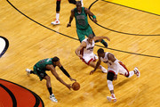 (Clockwise from bottom L) Paul Pierce #34 and Mickael Pietrus #28 of the Boston Celtics chase down a loose ball against Shane Battier #31 and Dwyane Wade #3 in the second half.of Game Two of the Eastern Conference Finals in the 2012 NBA Playoffs on May 30, 2012 at American Airlines Arena in Miami, Florida. NOTE TO USER: User expressly acknowledges and agrees that, by downloading and or using this photograph, User is consenting to the terms and conditions of the Getty Images License Agreement.