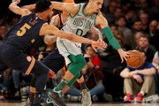 Courtney Lee #5 of the New York Knicks tries to steal the ball from Jayson Tatum #0 of the Boston Celtics at Madison Square Garden on February 24,2018 in New York City. NOTE TO USER: User expressly acknowledges and agrees that, by downloading and or using this Photograph, user is consenting to the terms and conditions of the Getty Images License Agreement