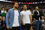 James Horwill, Tim Visser and Jamie Roberts of Harlequins attend the NBA game between Boston Celtics and Philadelphia 76ers at The O2 Arena on January 11, 2018 in London, England.