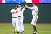 Outfielders Michael Bourn #24 and Michael Brantley #23 celebrate with David Murphy #7 of the Cleveland Indians after the Indians defeated the Boston Red Sox at Progressive Field on June 2, 2014 in Cleveland, Ohio. The Indians defeated the Red Sox 3-2.