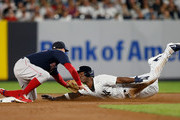 Andrew McCutchen #26 of the New York Yankees is caught stealing second base by Brock Holt #12 of the Boston Red Sox during the first inning at Yankee Stadium on September 20, 2018 in the Bronx borough of New York City.