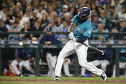 Denard Span #4 of the Seattle Mariners doubles to right field to score Andrew Romine #7 and Ben Gamel #16 to take the lead over the Boston Red Sox in the eighth inning of the game at Safeco Field on June 15, 2018 in Seattle, Washington.