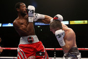 Liam Smith of Great Britain and John Thompson of The USA exchange blows during their WBO World Super Welterweight championship bout at Manchester Arena on October 10, 2015 in Manchester, England.