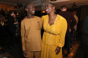 "Maxwell Simba and Aissa Maiga attend the Drinks Reception of the Netflix film ""The Boy Who Harnessed The Wind"" during the 69th Berlinale International Film Festival Berlin at Soho House on February 12, 2019 in Berlin, Germany."