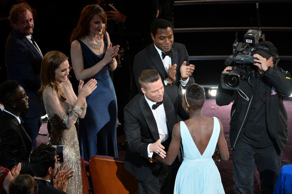 86th Annual Academy Awards Show [12 years a slave,event,suit,formal wear,fashion,performance,premiere,dress,musical ensemble,tuxedo,ceremony,lupita nyongo,brad pitt,angelina jolie,chiwetel ejiofor,r,award,best performance by an actress in a supporting role,l-r,annual academy awards show]