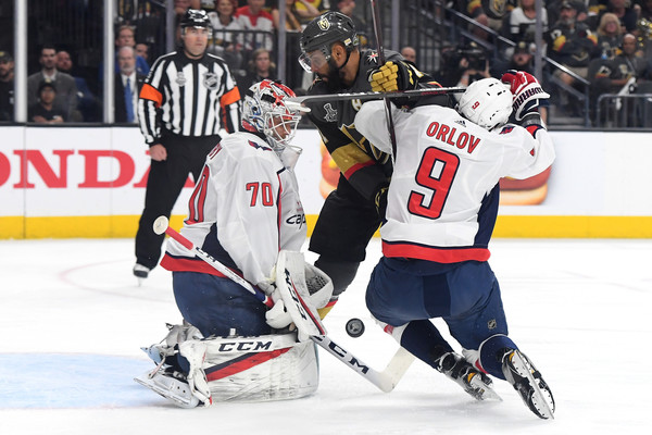2018 NHL Stanley Cup Final - Game Five [player,college ice hockey,ice hockey,ice hockey position,sports,sports gear,hockey protective equipment,team sport,ball game,hockey,pierre-edouard bellemare,dmitry orlov 9,five,shot,braden holtby 70,t-mobile arena,nhl,vegas golden knights,washington capitals,stanley cup final]