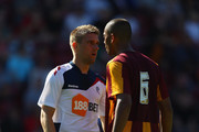 Ivan Klasnic of Bolton Wanderers confronts Steve Williams of Bradford City during the pre season friendly match between Bradford City and Bolton Wanderers at Coral Windows Stadium, Valley Parade on July 24, 2011 in Bradford, England.