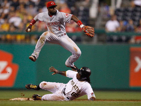 Brandon Phillips Brandon Phillips #4 of the Cincinnati Reds attempts to turn the double play over Lastings Milledge #85 of the Pittsburgh Pirates during the game on August 3, 2010 at PNC Park in Pittsburgh, Pennsylvania.