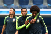 Gabriel Jesus (L) and Willian talk during a Brazil training session during the FIFA World Cup 2018 at Rostov Arena on June 14, 2018 in Rostov-on-Don, Russia.