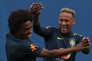 Neymar Jr (R) plays with Willian during a training session at Yug-Sport Stadium on June 19, 2018 in Sochi, Russia.