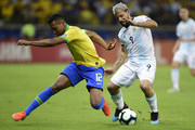 Alex Sandro of Brazil fights for the ball with Sergio Aguero of Argentina during the Copa America Brazil 2019 Semi Final match between Brazil and Argentina at Mineirao Stadium on July 02, 2019 in Belo Horizonte, Brazil.