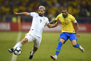 Sergio Aguero of Argentina controls the ball against Dani Alves of Brazil during the Copa America Brazil 2019 Semi Final match between Brazil and Argentina at Mineirao Stadium on July 02, 2019 in Belo Horizonte, Brazil.