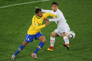 Robinho of Brazil and Gonzalo Jara of Chile battle for the ball during the 2010 FIFA World Cup South Africa Round of Sixteen match between Brazil and Chile at Ellis Park Stadium on June 28, 2010 in Johannesburg, South Africa.