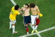 Marcelo (L) and David Luiz of Brazil console James Rodriguez of Colombia after Brazil's 2-1 win during the 2014 FIFA World Cup Brazil Quarter Final match between Brazil and Colombia at Castelao on July 4, 2014 in Fortaleza, Brazil.