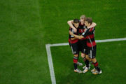 Andre Schuerrle of Germany (C) celebrates scoring his team's sixth goal with Mesut Oezil (L) and Thomas Mueller during the 2014 FIFA World Cup Brazil Semi Final match between Brazil and Germany at Estadio Mineirao on July 8, 2014 in Belo Horizonte, Brazil.