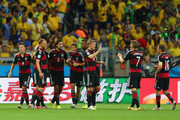 Sami Khedira of Germany (3rd R) celebrates wth his team-mates (L-R)  Mesut Oezil, Benedikt Hoewedes, Thomas Mueller, Jerome Boateng, Toni Kroos, Bastian Schweinsteiger and Philipp Lahm after scoring their fifth goal during the 2014 FIFA World Cup Brazil Semi Final match between Brazil and Germany at Estadio Mineirao on July 8, 2014 in Belo Horizonte, Brazil.