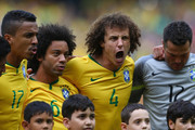 L-R) Luiz Gustavo of Brazil, Marcelo, David Luiz and Julio Cesar  during the national anthems ahead of the 2014 FIFA World Cup Brazil Group A match between Brazil and Mexico at Arena Castelao on June 17, 2014 in Fortaleza, Brazil.