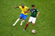 Carlos Vela of Mexico is challenged by Miranda of Brazil  during the 2018 FIFA World Cup Russia Round of 16 match between Brazil and Mexico at Samara Arena on July 2, 2018 in Samara, Russia.