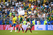 Javier Hernandez of Mexico and Andres Guardado of Mexico look dejected following their sides defeat in the 2018 FIFA World Cup Russia Round of 16 match between Brazil and Mexico at Samara Arena on July 2, 2018 in Samara, Russia.