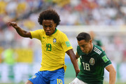 Willian of Brazil battles for possession with Andres Guardado of Mexico during the 2018 FIFA World Cup Russia Round of 16 match between Brazil and Mexico at Samara Arena on July 2, 2018 in Samara, Russia.