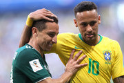 Neymar Jr of Brazil talks to Andres Guardado of Mexico during the 2018 FIFA World Cup Russia Round of 16 match between Brazil and Mexico at Samara Arena on July 2, 2018 in Samara, Russia.