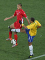 Jong Tae-Se of North Korea and Felipe Melo of Brazil battle for the ball during the 2010 FIFA World Cup South Africa Group G match between Brazil and North Korea at Ellis Park Stadium on June 15, 2010 in Johannesburg, South Africa.