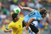 Diego Forlan of Uruguay competes with Thiago Silva of Brazil  during the FIFA Confederations Cup Brazil 2013 Semi Final match between Brazil and Uruguay at Governador Magalhaes Pinto Estadio Mineirao on June 26, 2013 in Belo Horizonte, Brazil.