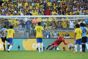 Julio Cesar of Brazil saves the penalty kick of Diego Forlan of Uruguay during the FIFA Confederations Cup Brazil 2013 Semi Final match between Brazil and Uruguay at Governador Magalhaes Pinto Estadio Mineirao on June 26, 2013 in Belo Horizonte, Brazil.
