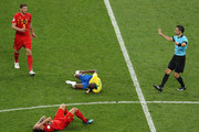 Fernandinho of Brazil and Axel Witsel of Belgium lie on the pitch injured during the 2018 FIFA World Cup Russia Quarter Final match between Brazil and Belgium at Kazan Arena on July 6, 2018 in Kazan, Russia.