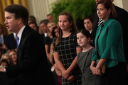 U.S. Supreme Court Justice Brett Kavanaugh (L) speaks as his wife Ashley (R), daughters Liza (2nd L) and Margaret (3rd L) look on during a ceremonial swearing in at the East Room of the White House October 08, 2018 in Washington, DC. Kavanaugh was confirmed in the Senate 50-48 after a contentious process that included several women accusing Kavanaugh of sexual assault. Kavanaugh has denied the allegations.