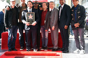 (L-R) Edward Norton, Dwayne Johnson, Brett Ratner, Eddie Murphy, Brian Grazer, Kevin Tsujihara, Chris Rock and Russell Simmons attend Ratner's star on the Walk of Fame ceremony in Hollywood on January 19, 2017. / AFP / CHRIS DELMAS