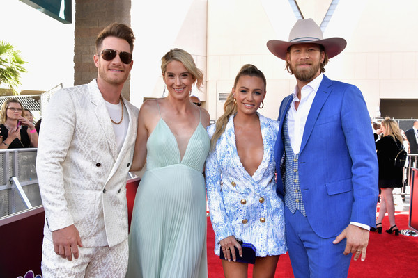 2019 Billboard Music Awards - Red Carpet [red carpet,red,red carpet,event,fashion,carpet,flooring,dress,fashion accessory,suit,ceremony,brian kelley,hayley stommel,tyler hubbard,brittney marie cole,billboard music awards,l-r,mgm grand garden arena,las vegas,florida georgia line]