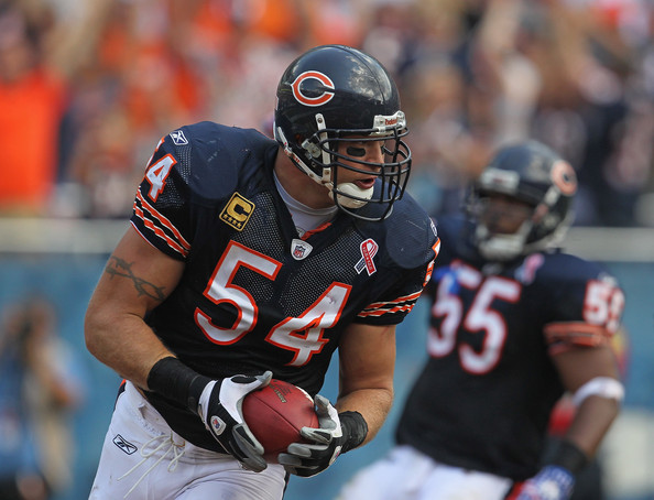 Brian Urlacher Brian Urlacher #54 of the Chicago Bears crosses the goal line for a touchdown after picking up a fumbled ball against the Atlanta Falcons at Soldier Field on September 11, 2011 in Chicago, Illinois. The Bears defeated the Falcons 30-12.