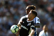 Luciano Vietto of Fulham holds off Gaetan Bong of Brighton and Hove Albion during the Premier League match between Brighton & Hove Albion and Fulham FC at American Express Community Stadium on September 1, 2018 in Brighton, United Kingdom.