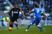 Scott Parker (L) of Fulham holds up the ball during the Sky Bet Championship match between Brighton & Hove Albion and Fulham at The Amex Stadium on November 29, 2014 in Brighton, England.