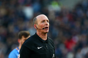 Referee Mike Dean reacts during the Premier League match between Brighton and Hove Albion and Swansea City at Amex Stadium on February 24, 2018 in Brighton, England.