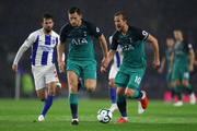Harry Kane of Tottenham Hotspur gives instructions to Jan Vertonghen of Tottenham Hotspur as he runs with the ball during the Premier League match between Brighton & Hove Albion and Tottenham Hotspur at American Express Community Stadium on September 22, 2018 in Brighton, United Kingdom.