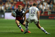 Ian Madigan of Bristol Bears takes on Jamie Roberts of Bath Rugby during the Gallagher Premiership Rugby match between Bristol Bears and Bath Rugby at Ashton Gate on August 31, 2018 in Bristol, United Kingdom.