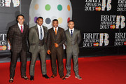 (L-R) Marvin Humes, Oritsé Williams, J.B. Gill and Aston Merrygold of JLS attend the Brit Awards 2013 at the 02 Arena on February 20, 2013 in London, England.