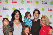 Esme Jones, actress Alicia Coppola, Greta Jones, Anthony Michael Jones, Britax's Kate Clark and Mila Jones attend a pre-Father's Day Mini Golf Open celebrating the summer launch of the Britax Baby Carrier hosted by Britax and Baby Buggy at Castle Park on June 11, 2011 in Sherman Oaks, California.