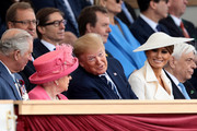 President of the United States, Donald Trump and First Lady of the United States, Melania Trump sit next to Prince Charles, Prince of Wales and Queen Elizabeth II as they attend the D-Day Commemorations on June 5, 2019 in Portsmouth, England. The political heads of 16 countries involved in World War II joined Her Majesty, The Queen on the UK south coast for a service to commemorate the 75th anniversary of D-Day. Overnight it was announced that all 16 had signed a historic proclamation of peace to ensure the horrors of the Second World War are never repeated. The text has been agreed by Australia, Belgium, Canada, Czech Republic, Denmark, France, Germany, Greece, Luxembourg, Netherlands, Norway, New Zealand, Poland, Slovakia, the United Kingdom and the United States of America.