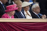 President of the United States, Donald Trump and First Lady of the United States, Melania Trump sit with Queen Elizabeth II and President of Greece, Prokopis Pavlopoulos (R) as they attend the D-Day Commemorations on June 5, 2019 in Portsmouth, England. The political heads of 16 countries involved in World War II joined Her Majesty, The Queen on the UK south coast for a service to commemorate the 75th anniversary of D-Day. Overnight it was announced that all 16 had signed a historic proclamation of peace to ensure the horrors of the Second World War are never repeated. The text has been agreed by Australia, Belgium, Canada, Czech Republic, Denmark, France, Germany, Greece, Luxembourg, Netherlands, Norway, New Zealand, Poland, Slovakia, the United Kingdom and the United States of America.
