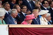 President of the United States, Donald Trump and First Lady of the United States, Melania Trump sit next to British Prime minister, Theresa May, Prince Charles, Prince of Wales, Queen Elizabeth II and the President of Greece, Prokopis Pavlopoulos (R) as they attend the D-Day Commemorations on June 5, 2019 in Portsmouth, England. The political heads of 16 countries involved in World War II joined Her Majesty, The Queen on the UK south coast for a service to commemorate the 75th anniversary of D-Day. Overnight it was announced that all 16 had signed a historic proclamation of peace to ensure the horrors of the Second World War are never repeated. The text has been agreed by Australia, Belgium, Canada, Czech Republic, Denmark, France, Germany, Greece, Luxembourg, Netherlands, Norway, New Zealand, Poland, Slovakia, the United Kingdom and the United States of America.