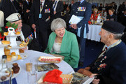 British Prime Minister Theresa May meets D-Day veterans at a veterans reception during the National Commemorative Event commemorating the 75th anniversary of the D-Day invasion on June 5, 2019 in Portsmouth, England. The political heads of 16 countries involved in World War II joined Her Majesty, The Queen on the UK south coast for a service to commemorate the 75th anniversary of D-Day. Overnight it was announced that all 16 had signed a historic proclamation of peace to ensure the horrors of the Second World War are never repeated. The text has been agreed by Australia, Belgium, Canada, Czech Republic, Denmark, France, Germany, Greece, Luxembourg, Netherlands, Norway, New Zealand, Poland, Slovakia, the United Kingdom and the United States of America.