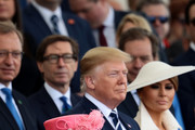 President of the United States, Donald Trump and First Lady of the United States, Melania Trump stand next to Queen Elizabeth II as they attend the D-Day Commemorations on June 5, 2019 in Portsmouth, England. The political heads of 16 countries involved in World War II joined Her Majesty, The Queen on the UK south coast for a service to commemorate the 75th anniversary of D-Day. Overnight it was announced that all 16 had signed a historic proclamation of peace to ensure the horrors of the Second World War are never repeated. The text has been agreed by Australia, Belgium, Canada, Czech Republic, Denmark, France, Germany, Greece, Luxembourg, Netherlands, Norway, New Zealand, Poland, Slovakia, the United Kingdom and the United States of America.