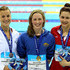 Hannah Miley Photos - Gold medallist Hannah Miley (C) of Garioch celebrates with silver medallist Aimee Willmott (R) of Middlesbrough and bronze medallist Stephanie Proud of Chester Le Street after the Women's Open 400m Individual Medley Final during day one of the British Gas Swimming Championships at the London Aquatics Centre on March 3, 2012 in London, England. - British Gas Swimming Championships - LOCOG Test Event for London 2012: Day One