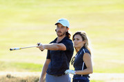 Tommy Fleetwood of England gives some advice to his Pro Am partner Zoe Hardman during the Hero Pro Am prior to the start of the British Masters supported by Sky Sports at Walton Heath Golf Club on October 10, 2018 in Tadworth, England.