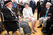 British Prime Minister Theresa May (C) meets veterans Leonard Williams (L) and Dorrell Kitcher (R) following a service of remembrance at Bayeux cemetery on June 06, 2019 in Bayeux, France. Veterans and families gathered in Normandy to commemorate D-Day's 75th anniversary. It has been announced that 16 countries had signed a historic proclamation of peace to ensure the horrors of the Second World War are never repeated. The text has been agreed by Australia, Belgium, Canada, Czech Republic, Denmark, France, Germany, Greece, Luxembourg, Netherlands, Norway, New Zealand, Poland, Slovakia, the United Kingdom and the United States of America.